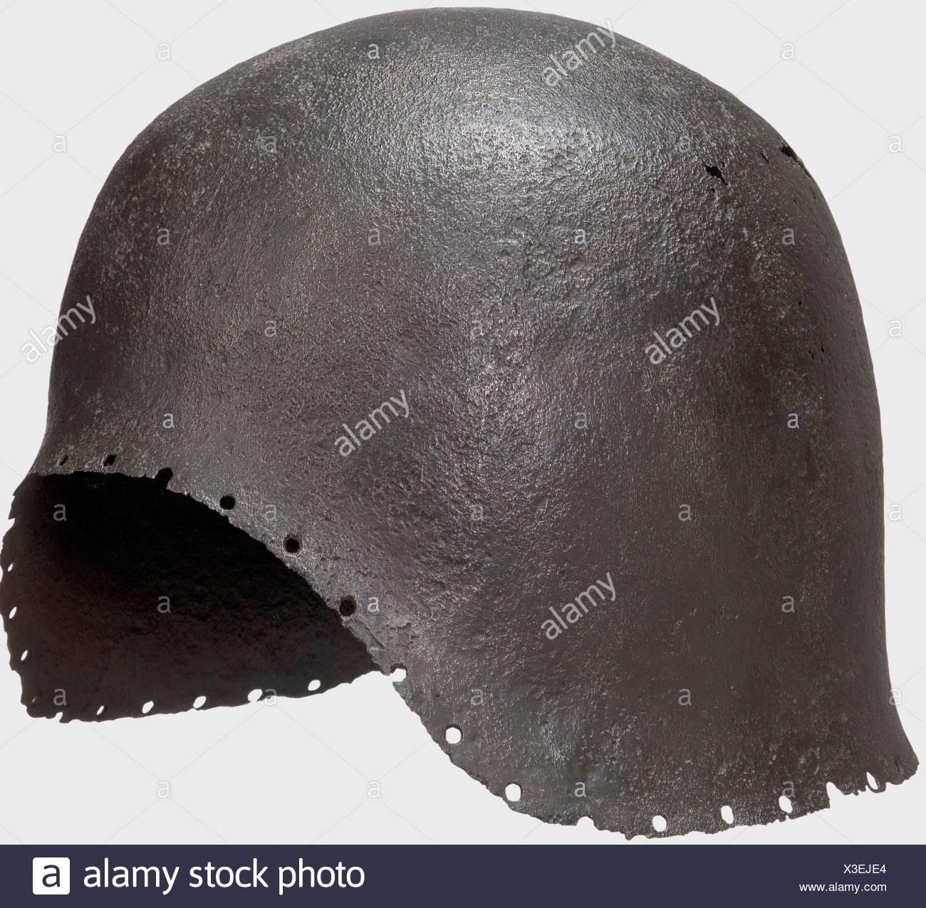 An Italian archer's sallet, Milan(?), middle of the 15th century One-piece hammered skull with a semicircular face cutout and a slightly flared edge. The perimeter with holes for the lining. The armourer's mark struck on the interior of the neck-guard. Cleaned excavation find, the skull with scattered corrosion holes. Height 19.5 cm. A simply fashioned enlisted man's helmet, whose markings can presumably be associated with a Milanese armourer. An early barbute with nearly identical mark is in the collection of Royal Armouries. See Karcheski, Walter J. 'The Medi, Additional-Rights-Clearances-NA - Stock Image