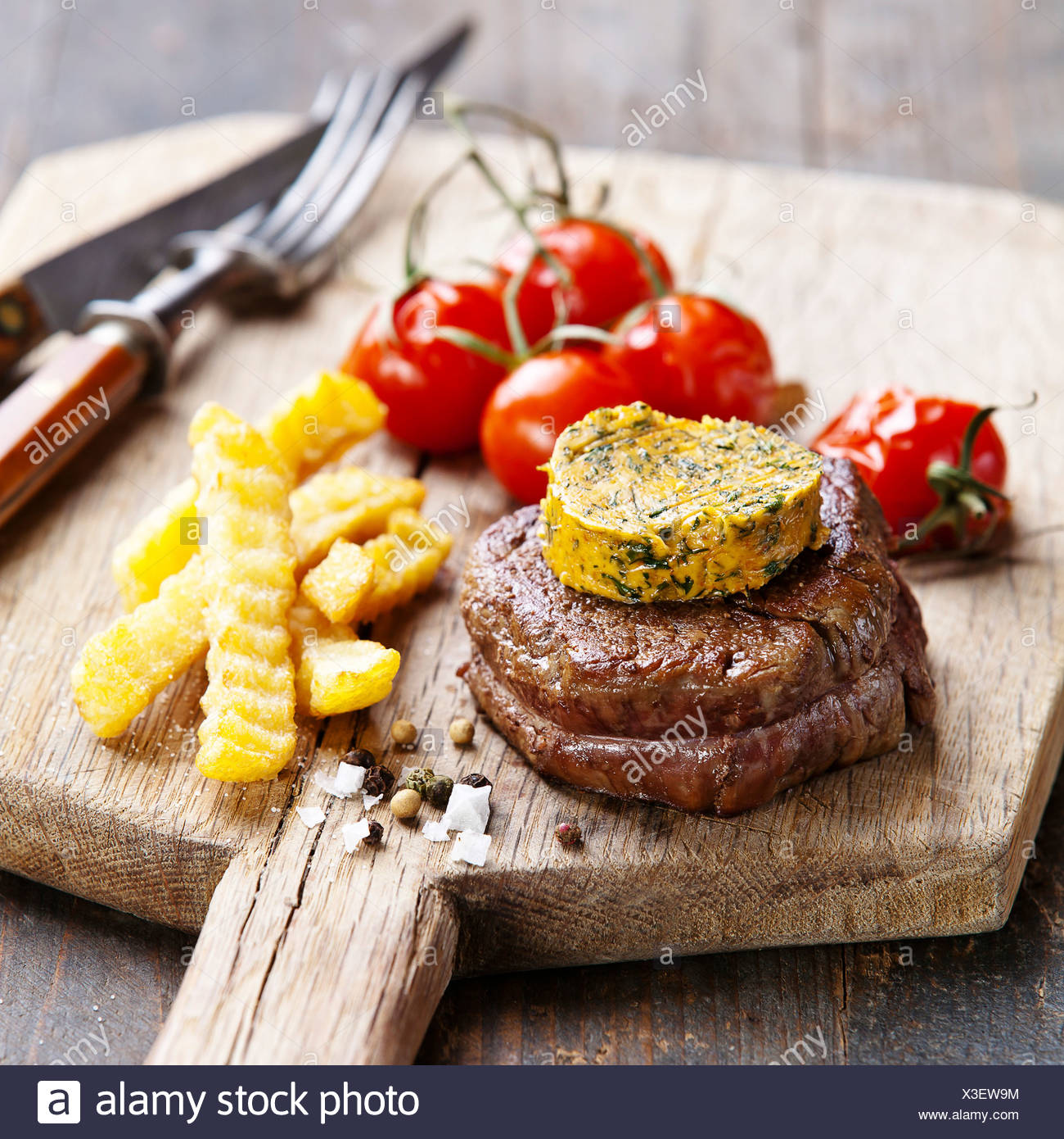 Beef Steak with Butter and Baked tomato - Stock Image