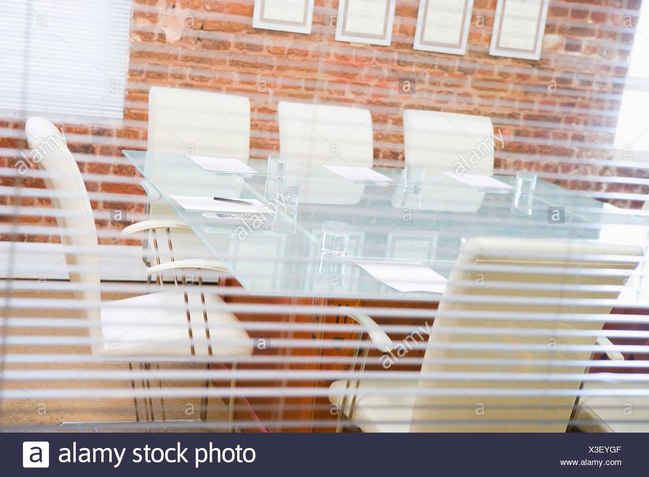 Empty boardroom through a window - Stock Image