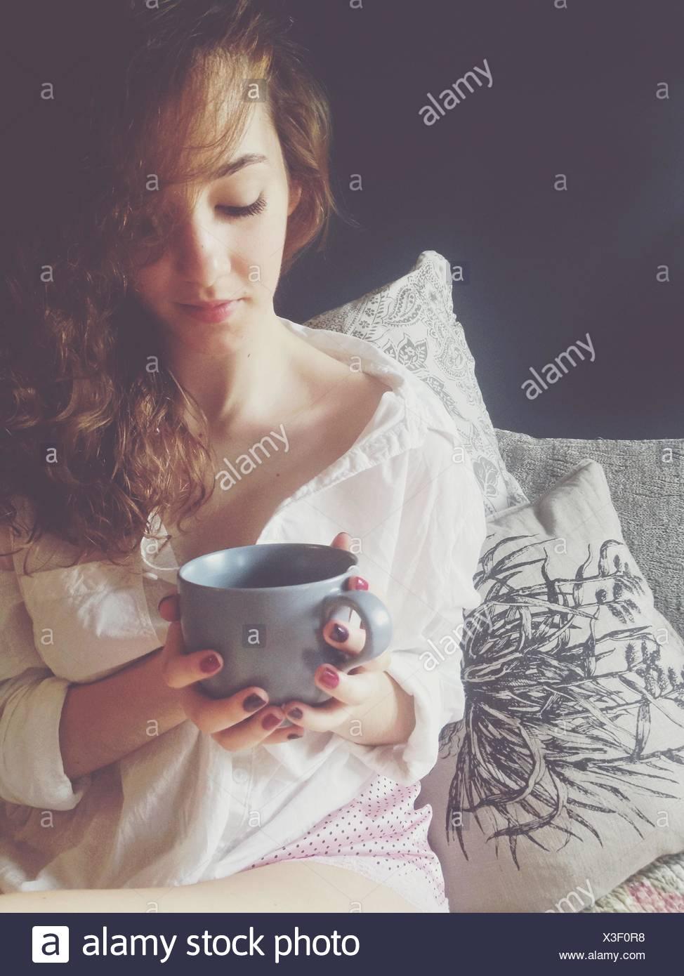 Woman Drinking Coffee - Stock Image