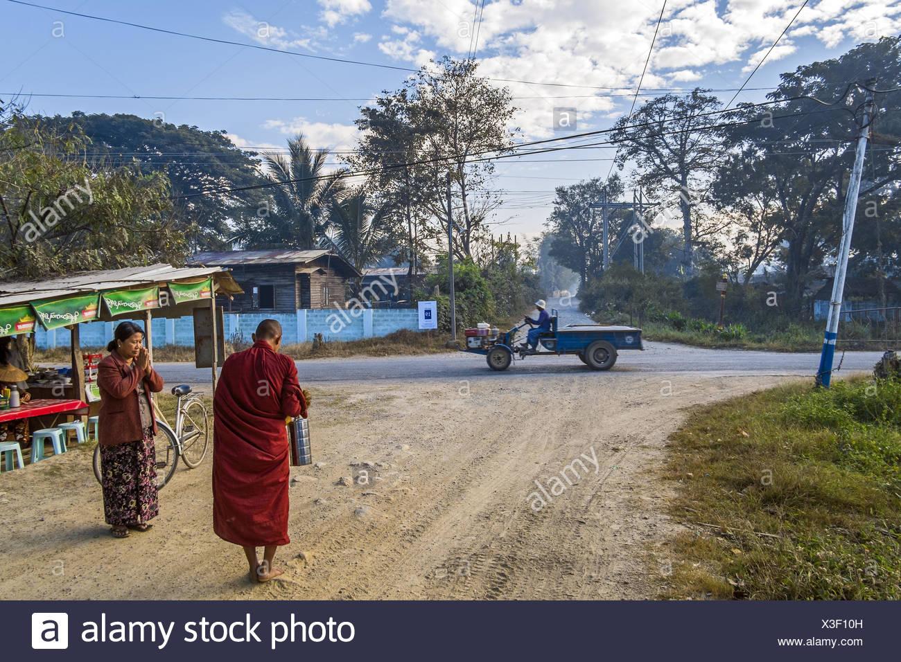 Young monc begging, Nyaung Shwe, Myanmar, Asia Stock Photo