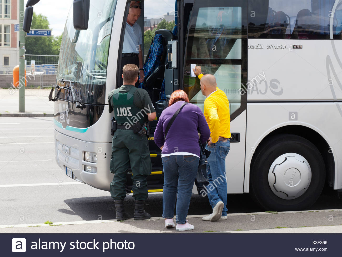 Customs officers inspecting a bus in Berlin Mitte, Germany, Europe - Stock Image