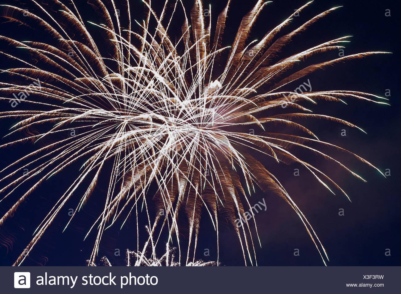 Fires, fireworks, pyrotechnics, rocket, rays, beams, explode, explosion, sky, darkly, sky, brightly, illuminates, light, - Stock Image