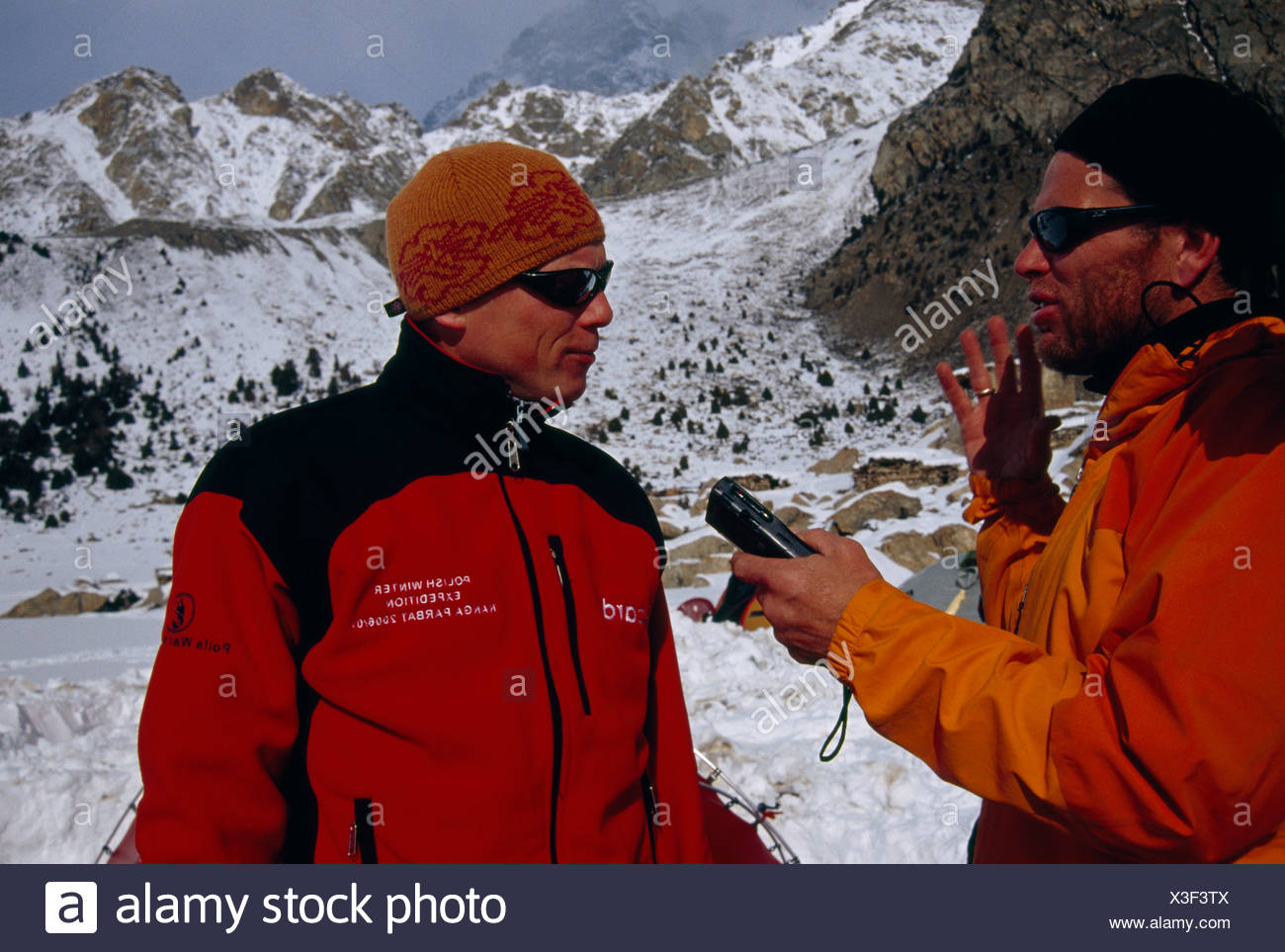 A National Geographic writer interviews an expedition team member. - Stock Image