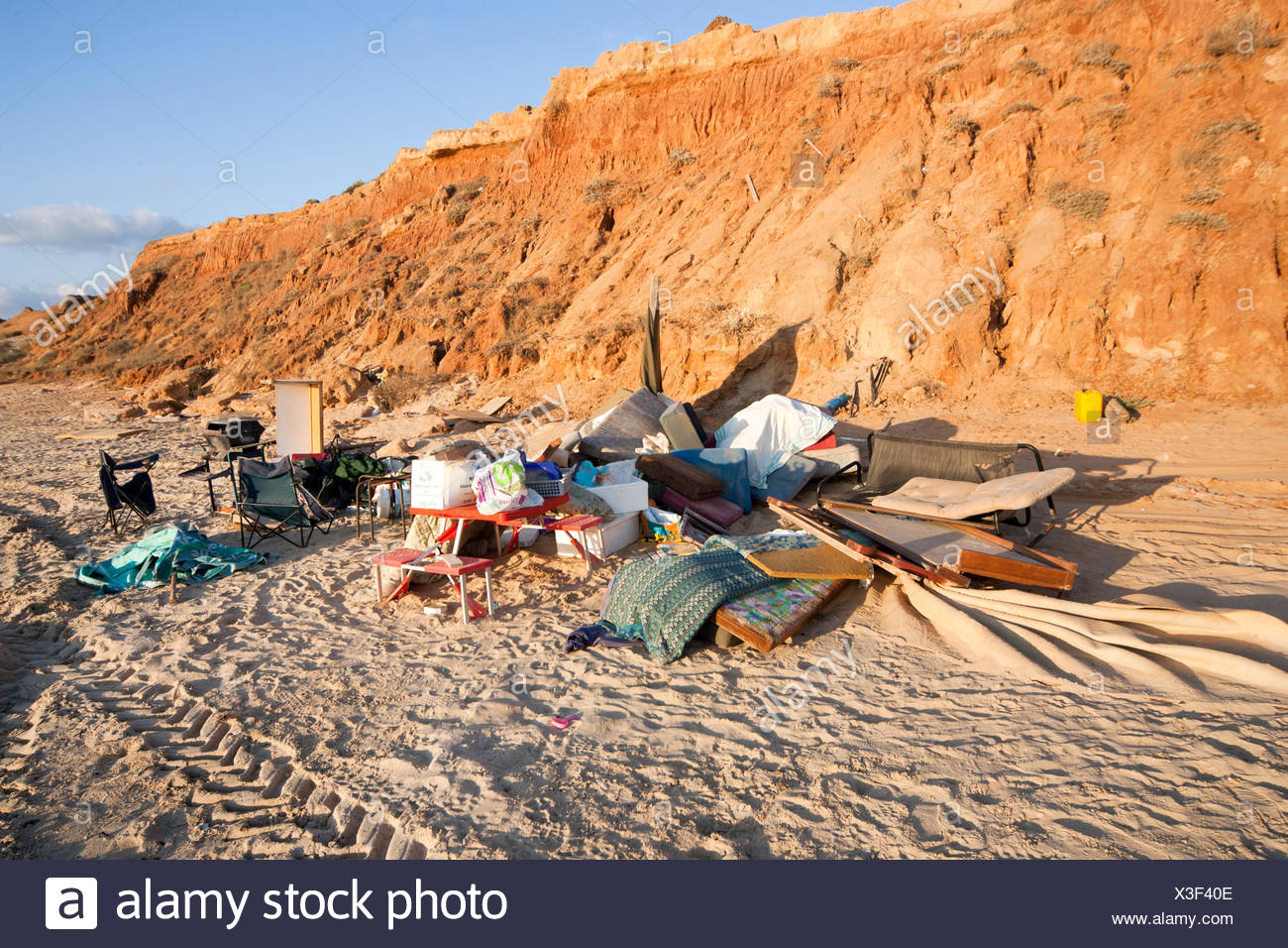 Garbage and waste left by holiday makers on a beach. Photographed in Israel - Stock Image