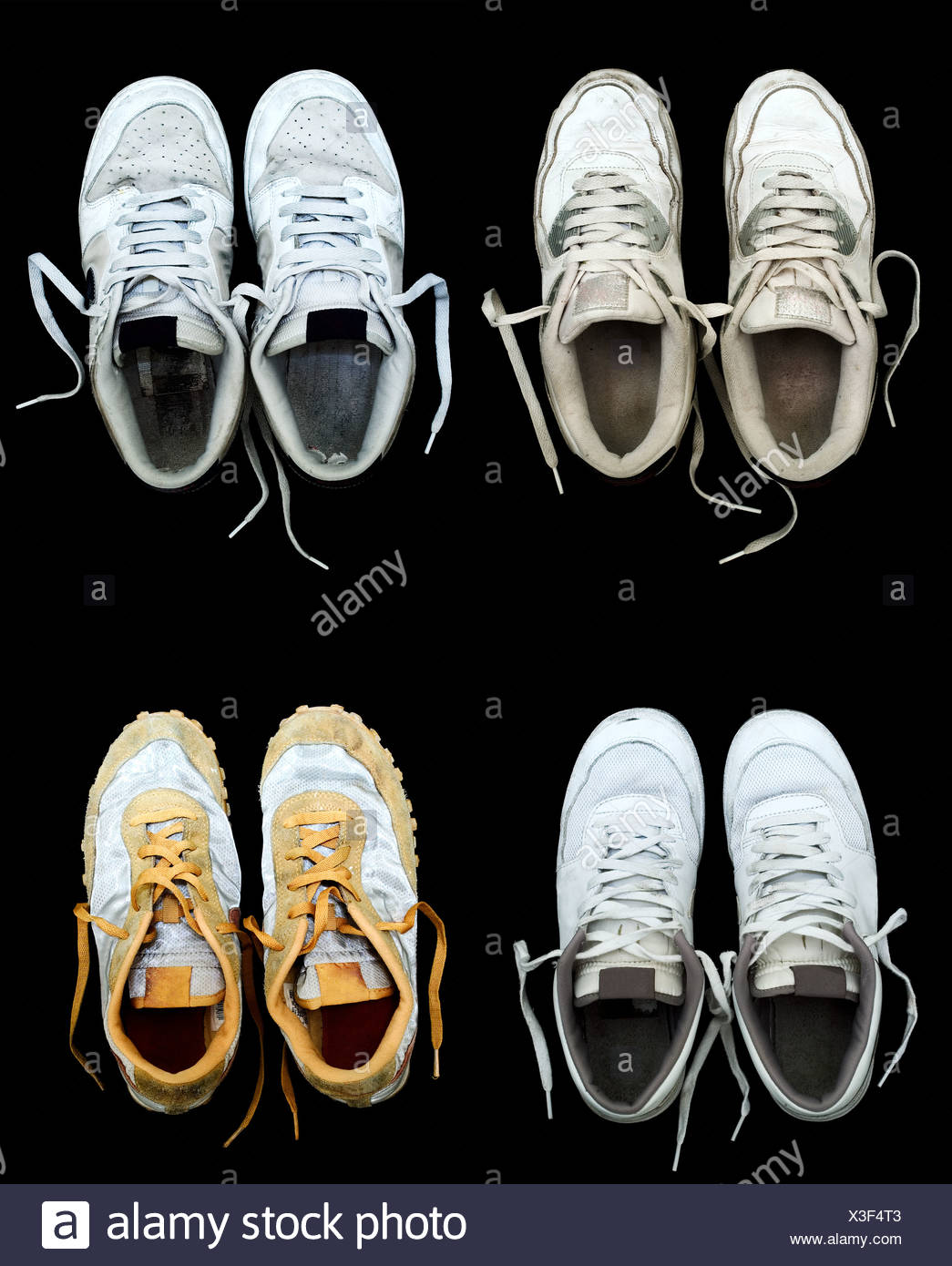 Four pairs of sports trainers - Stock Image