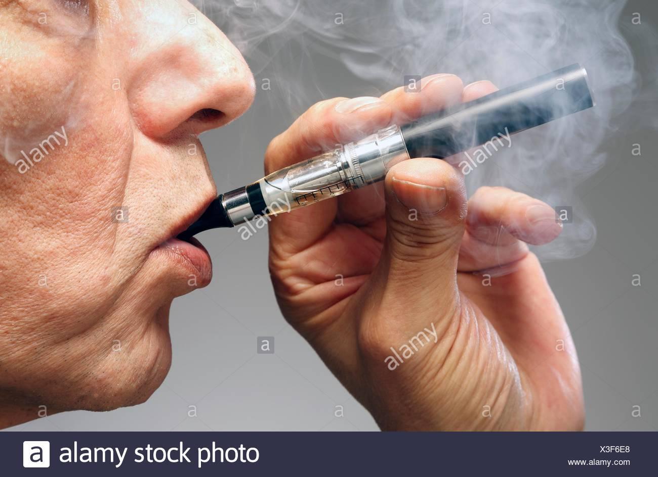 MODEL RELEASED. Person smoking e cigarette. - Stock Image
