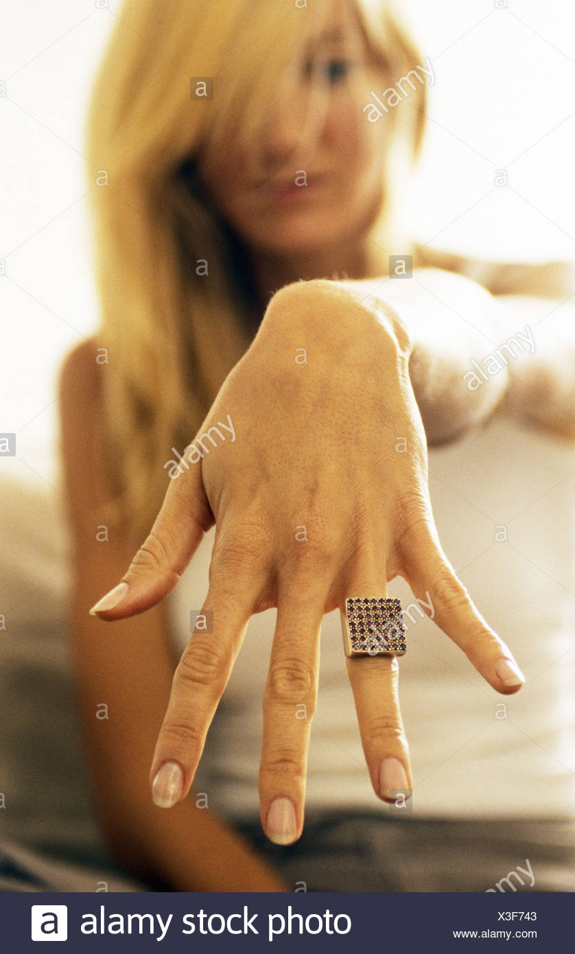 Woman showing ring to camera - Stock Image