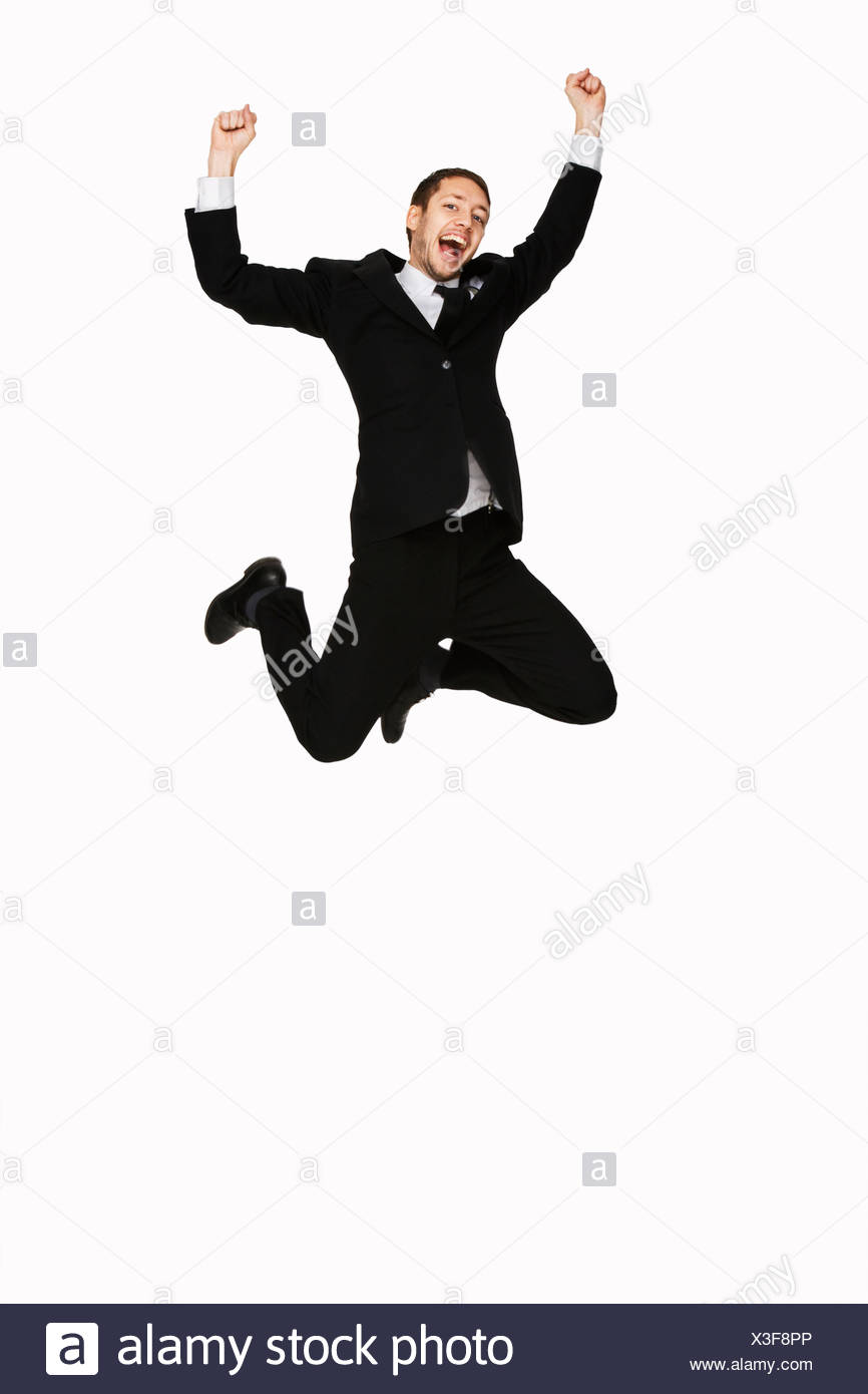 A man in a suit jumping Sweden - Stock Image
