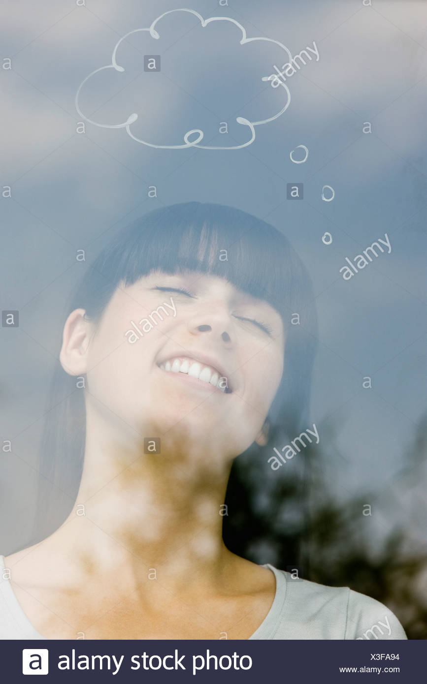 Young woman with thought bubble over head - Stock Image