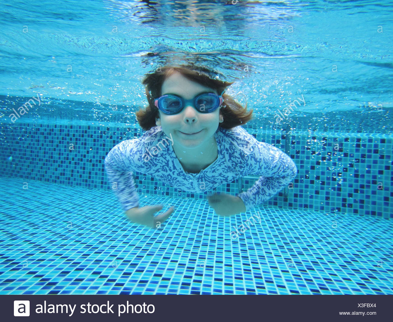 girl swimming underwater in swimming pool stock photo. Black Bedroom Furniture Sets. Home Design Ideas