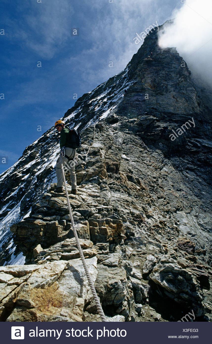 Climber descending hornli ridge on matterhorn - Stock Image