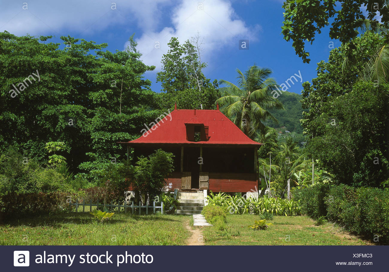Seychelles island La Digue house garden island state island-group residence framehouse typically Creole simply idyllically - Stock Image