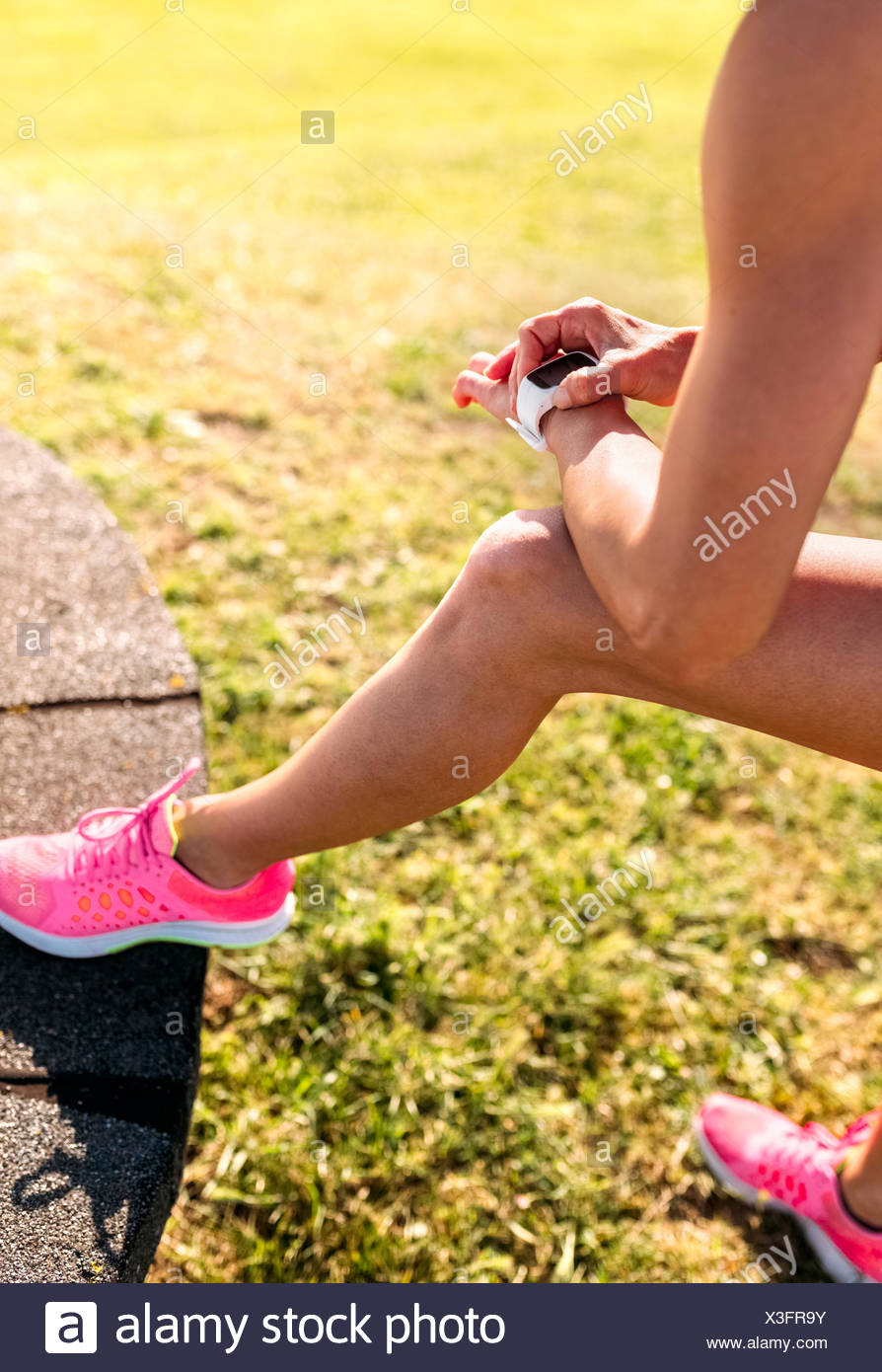 Woman checking heart rate monitor - Stock Image