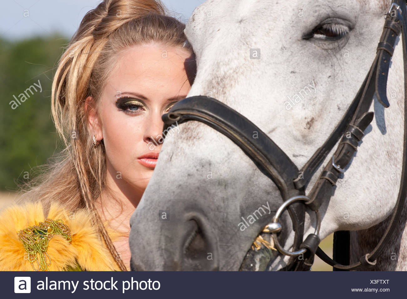 Horse and woman face to face - Stock Image