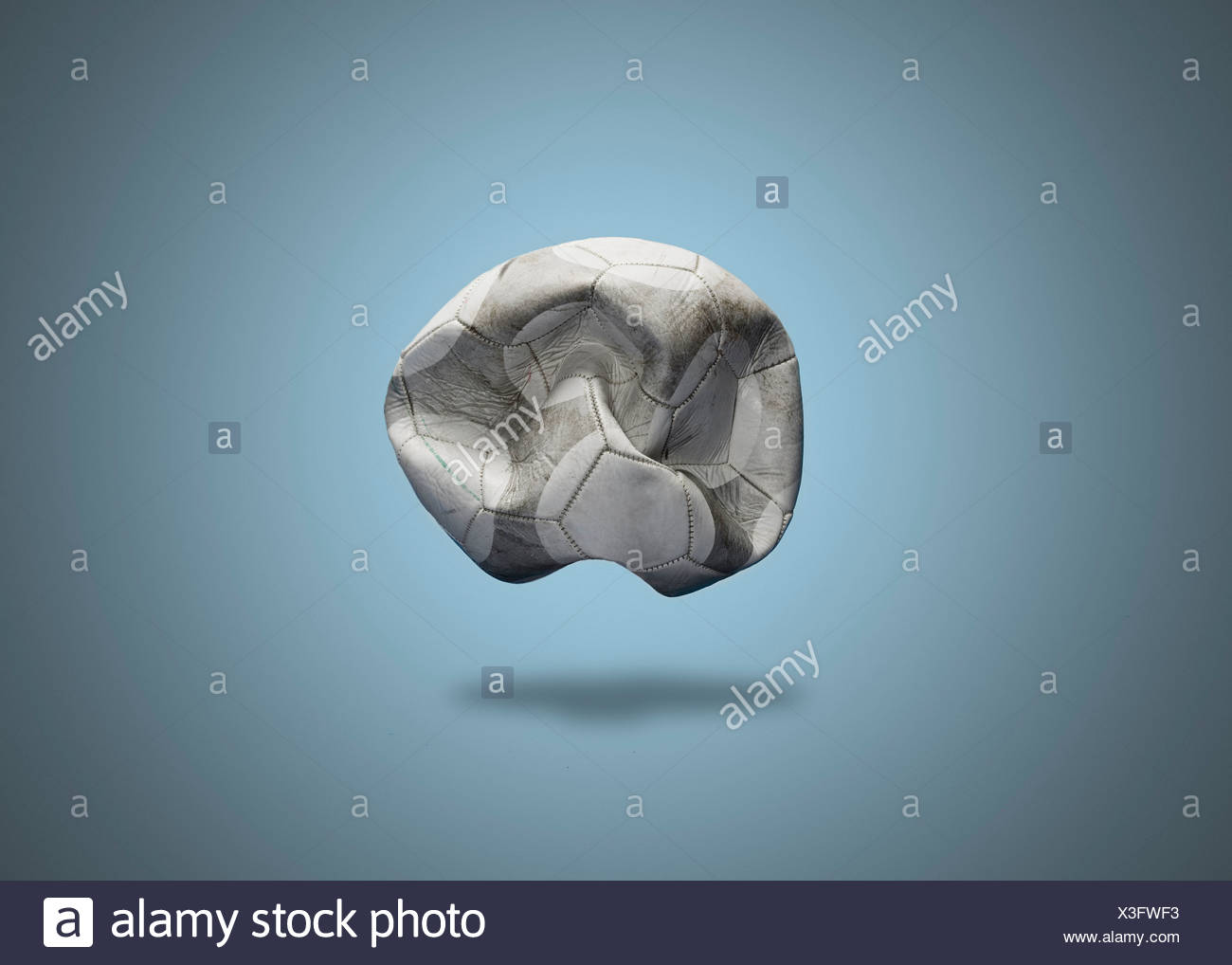 Close up of deflated soccer ball - Stock Image