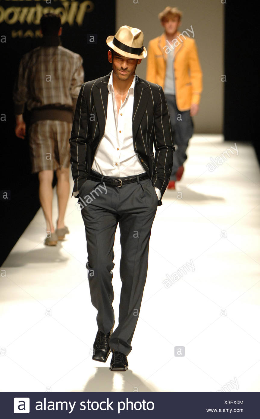 50eecd2377bd0 Vivienne Westwood Milan Menswear Ready to Wear Spring Summer Model wearing  cream and black fedora hat white open shirt and