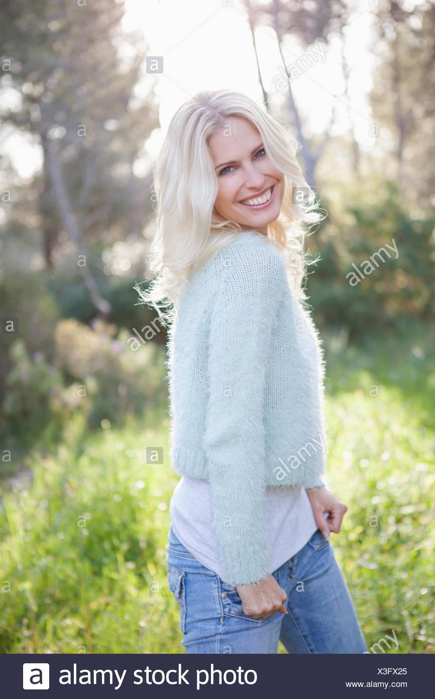 Woman in sunny garden - Stock Image