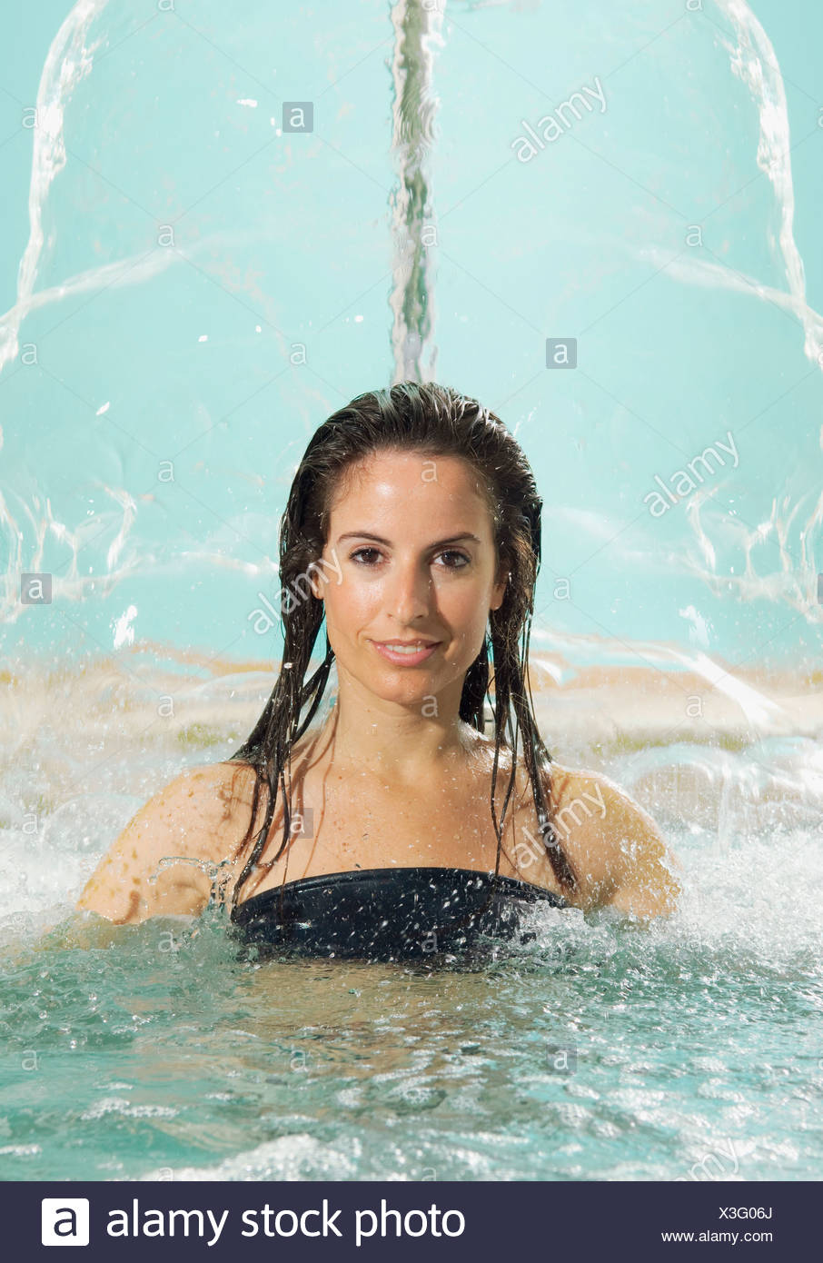 Young woman in hot tub - Stock Image