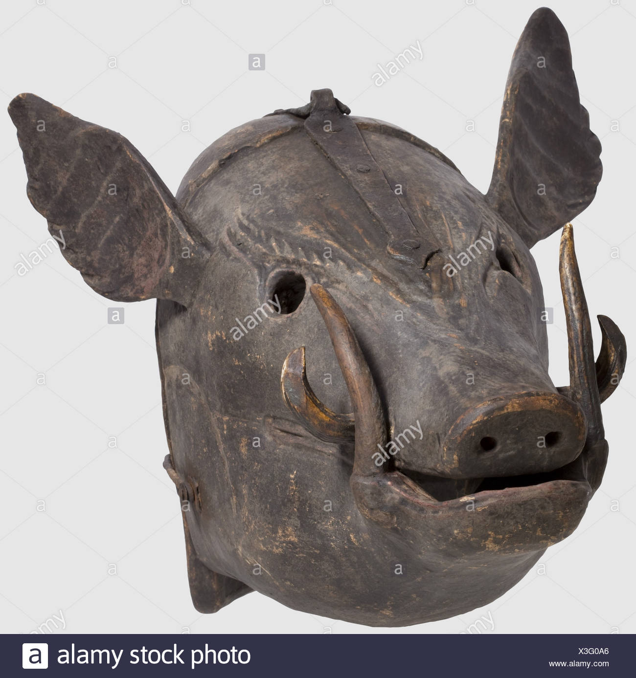 A German mask of shame, 17th/18th century. Carved wooden mask in the shape of a boar's head with inserted boar's teeth, the fangs made of stag horn, with attached flaring ears. The front and back piece connected at the crown by a wrought iron hinge and with a locking hook on the side. Dark, slightly worn paint. Length 48 cm, width 40 cm. Regarding material and design a rather unusual mask of shame, probably alluding to the delinquent's 'brutish' behaviour, historic, historical,, 18th century, 17th century, instrument of torture, torture device, instruments of t, Additional-Rights-Clearences-NA - Stock Image