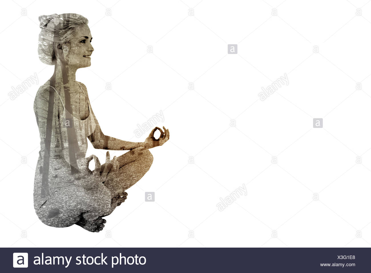 Composite image of full length of toned woman sitting in lotus position - Stock Image
