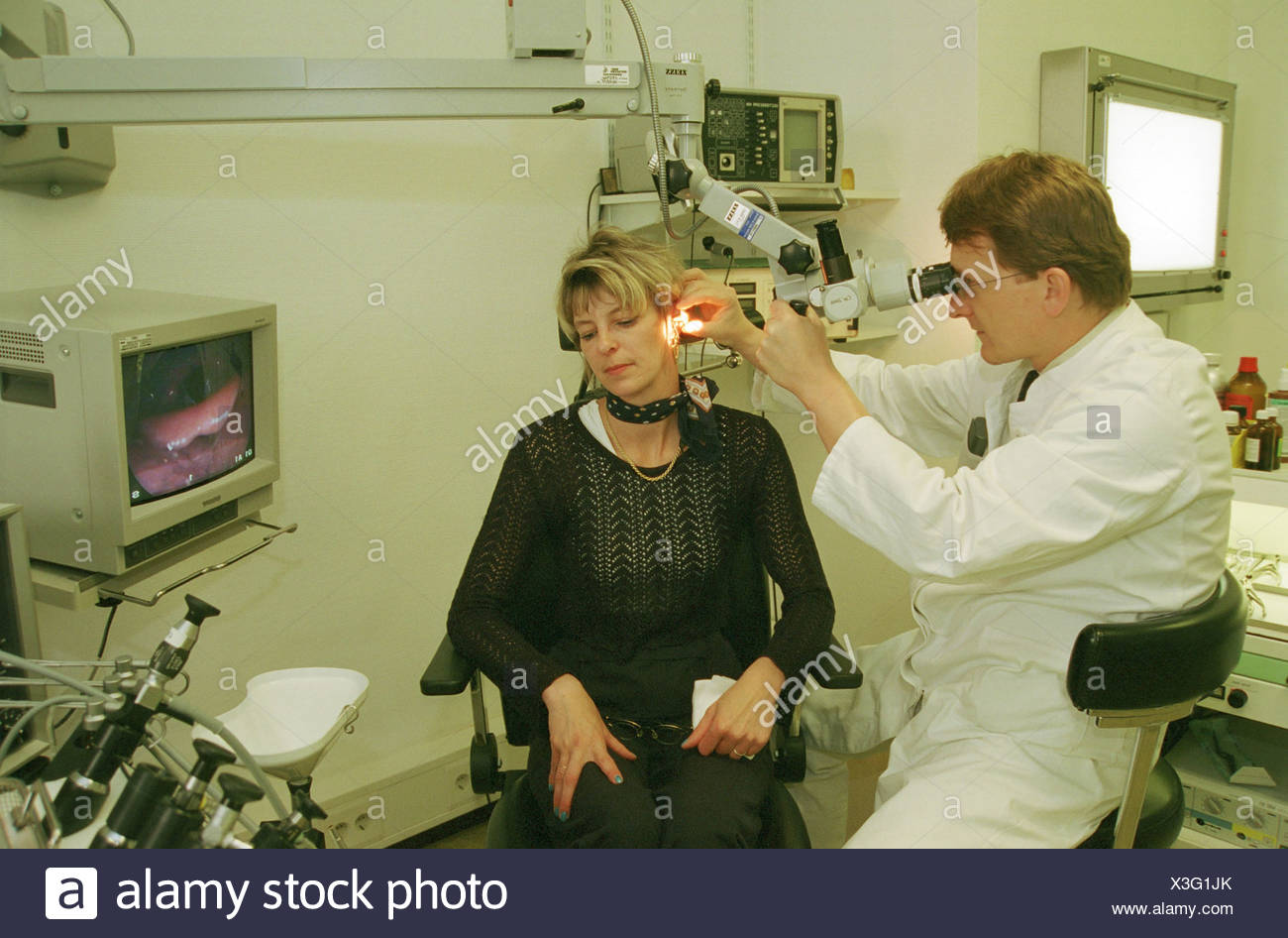 ENT doctor examines patient, Berlin - Stock Image