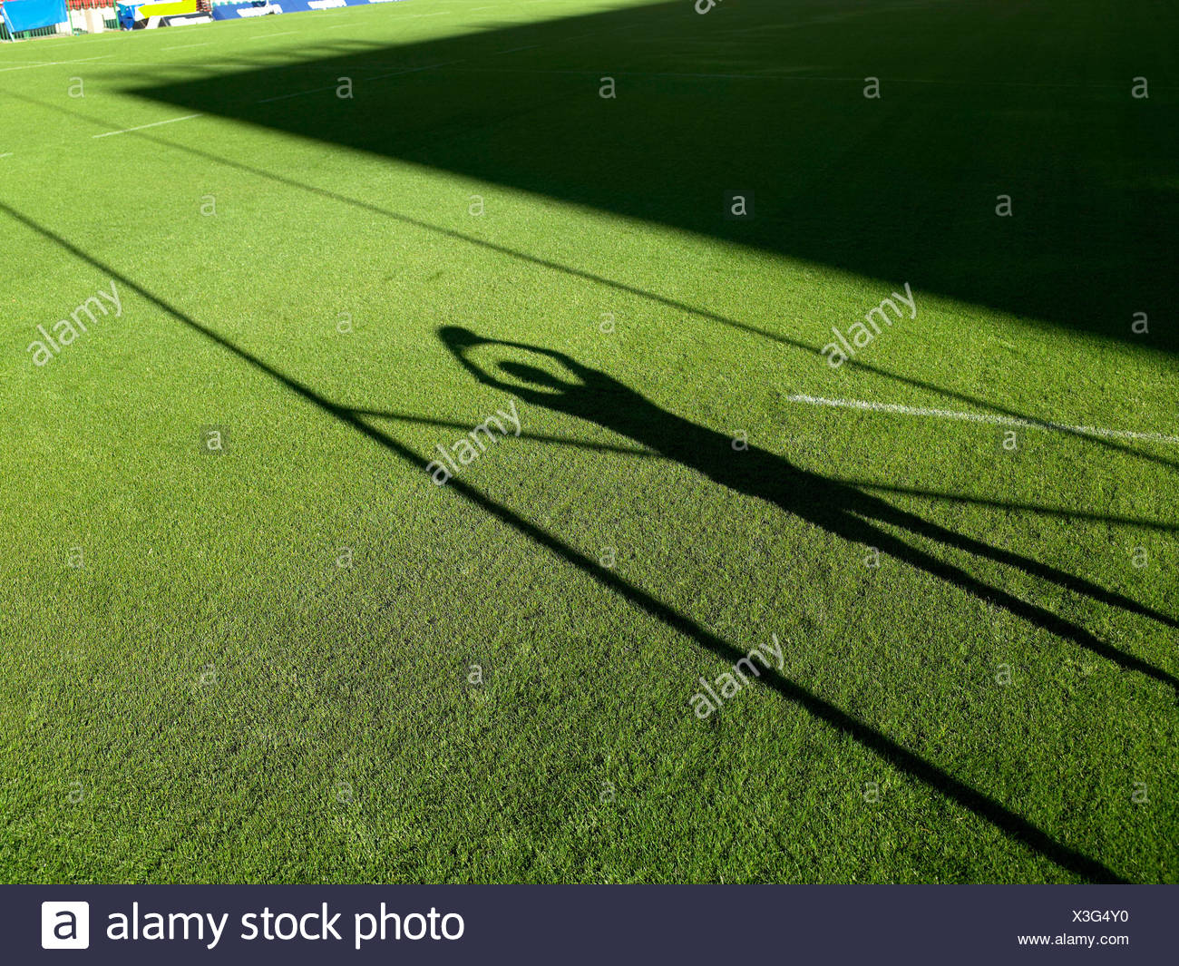 Shadow of rugby player and rugby post - Stock Image