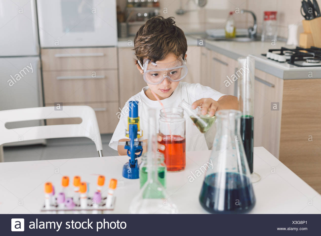 Boy playing science experiments at home Stock Photo
