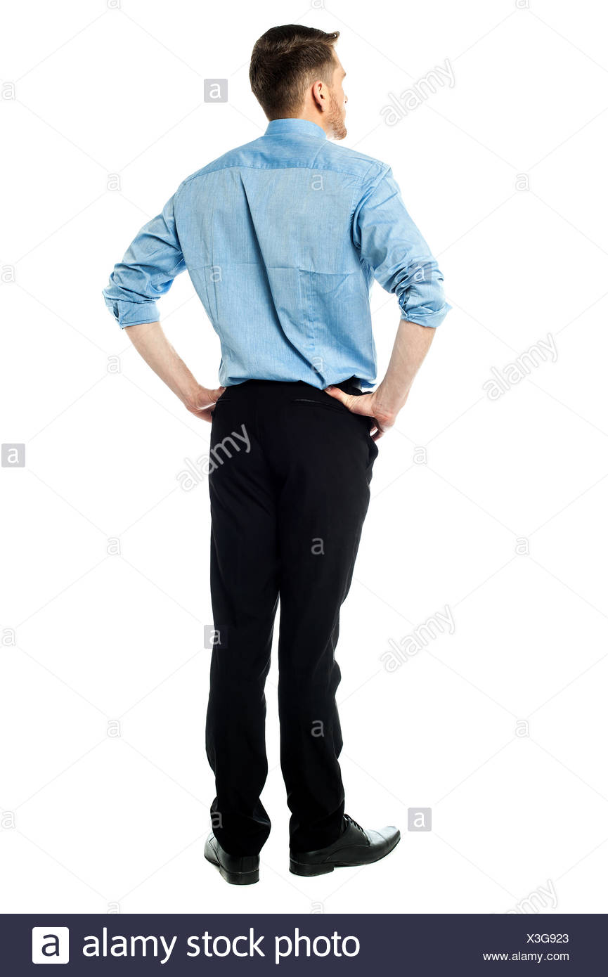 Back pose of a casual businessman - Stock Image