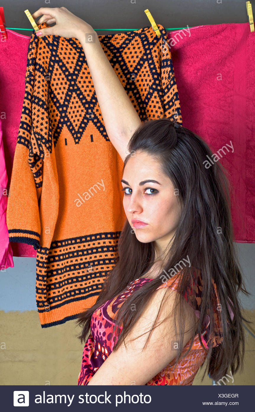 young woman hanging up the washing - Stock Image