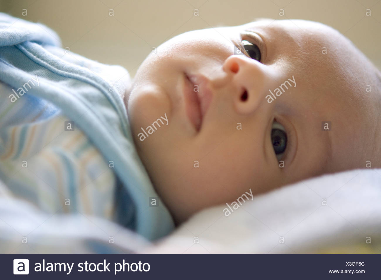 Close up of newborn's face - Stock Image