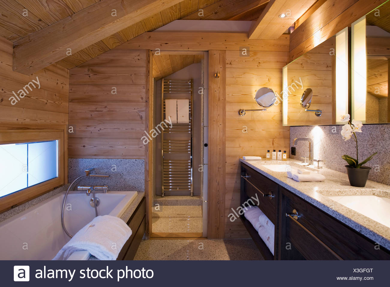Wooden Walls And Sloping Ceiling Of Bathroom In Modern Alpine Chalet