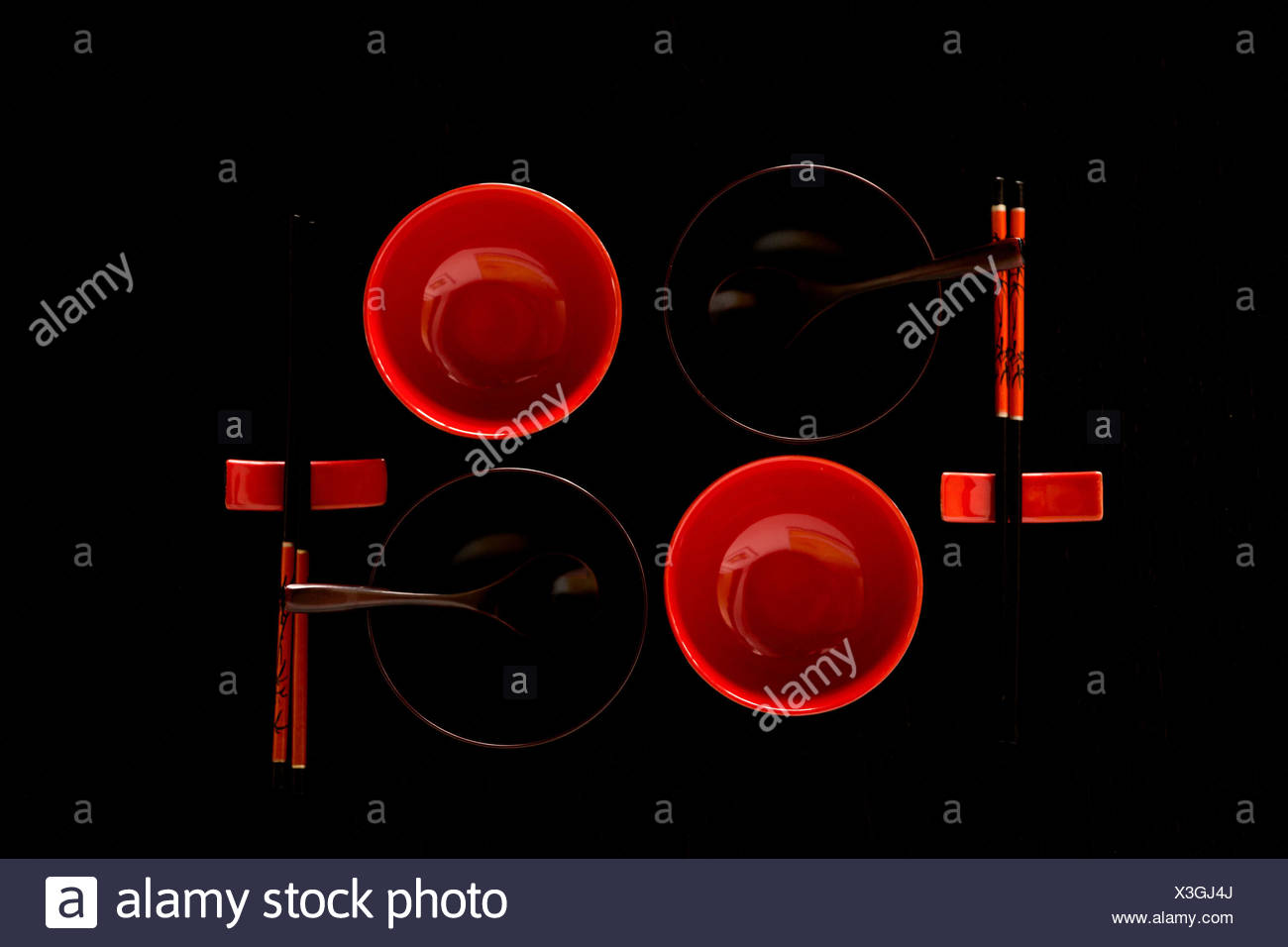 artistic,asian,beautiful,black,black background,black-red,chopsticks,cuisine,culture,cups,cut-out,dark,decoration,dining,Dunkel,east,empty,enjoyment,ethnic,for two,Genuss,gloom,Ilex,kitchen,light,lines,object,objects,orient,oriental,plate,pleasure,red,red - Stock Image