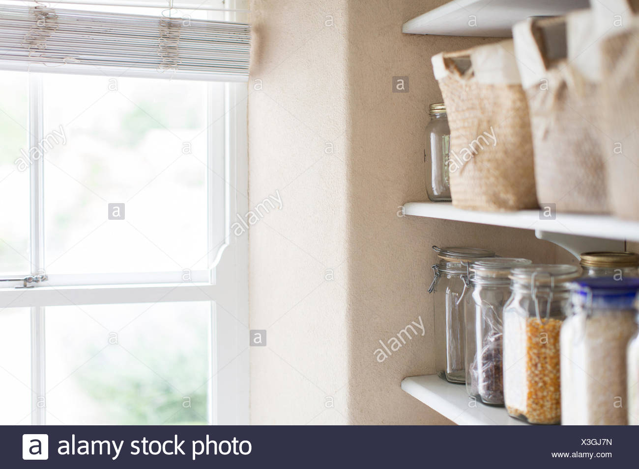 Dry goods and window of pantry Stock Photo