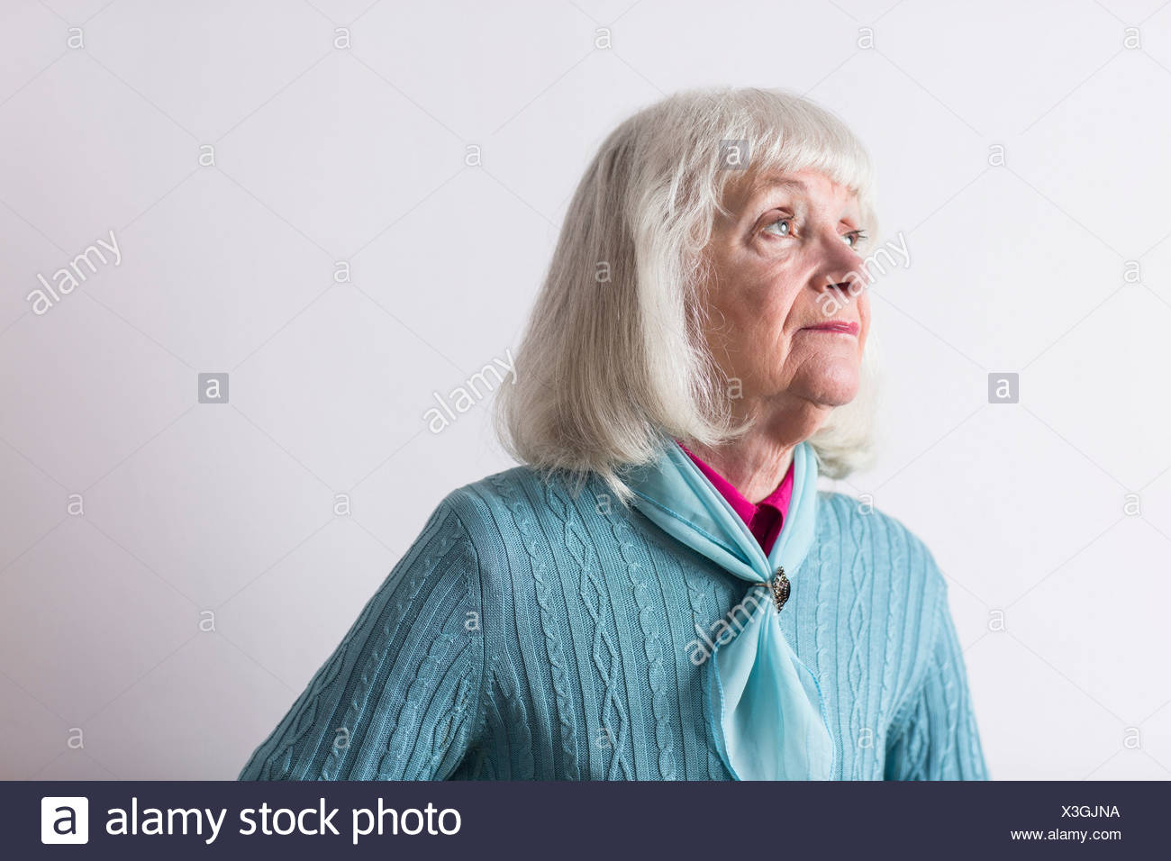 Senior woman with grey hair looking away - Stock Image