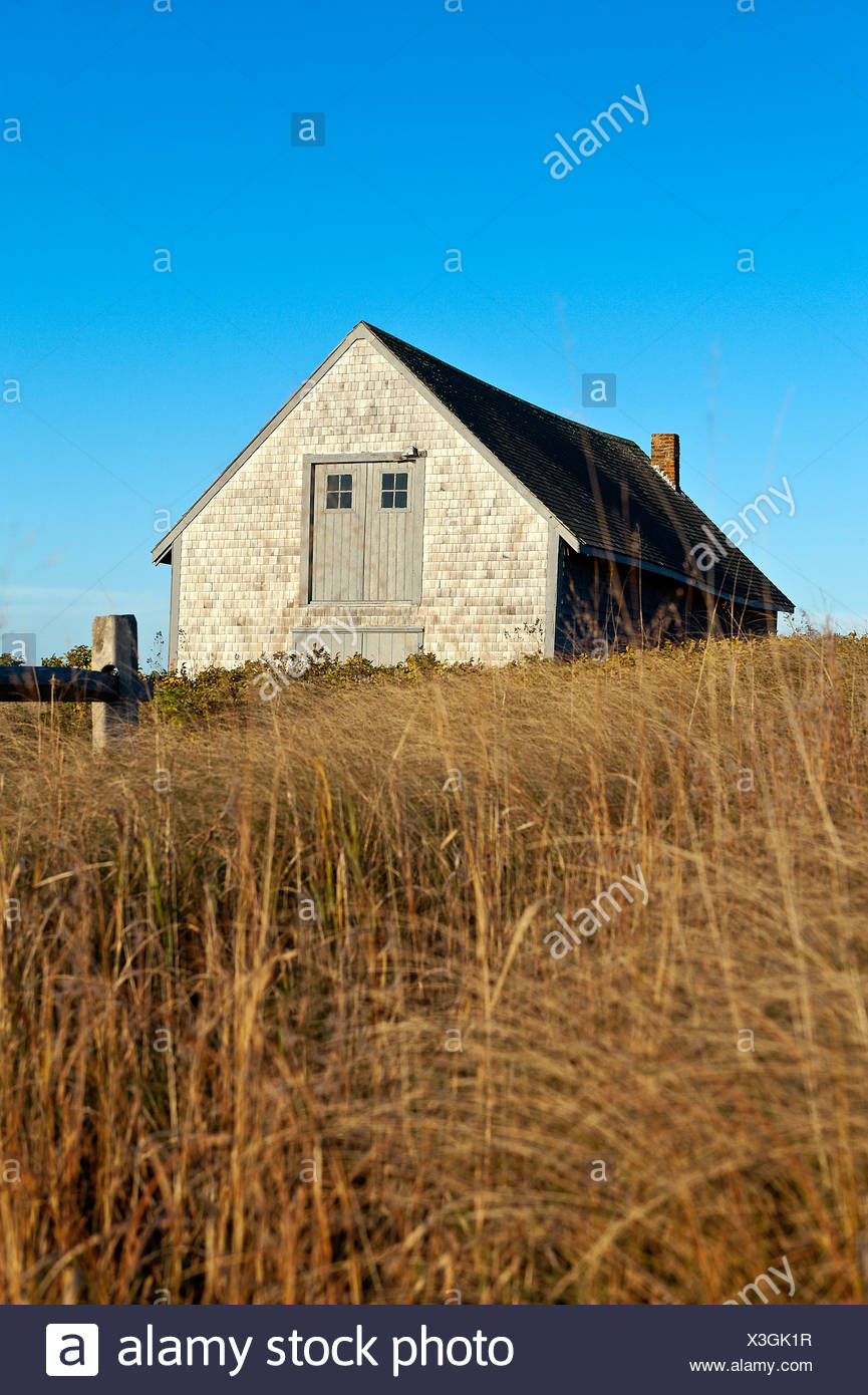 Boat house and Chatham harbor, Cape Cod, MA - Stock Image