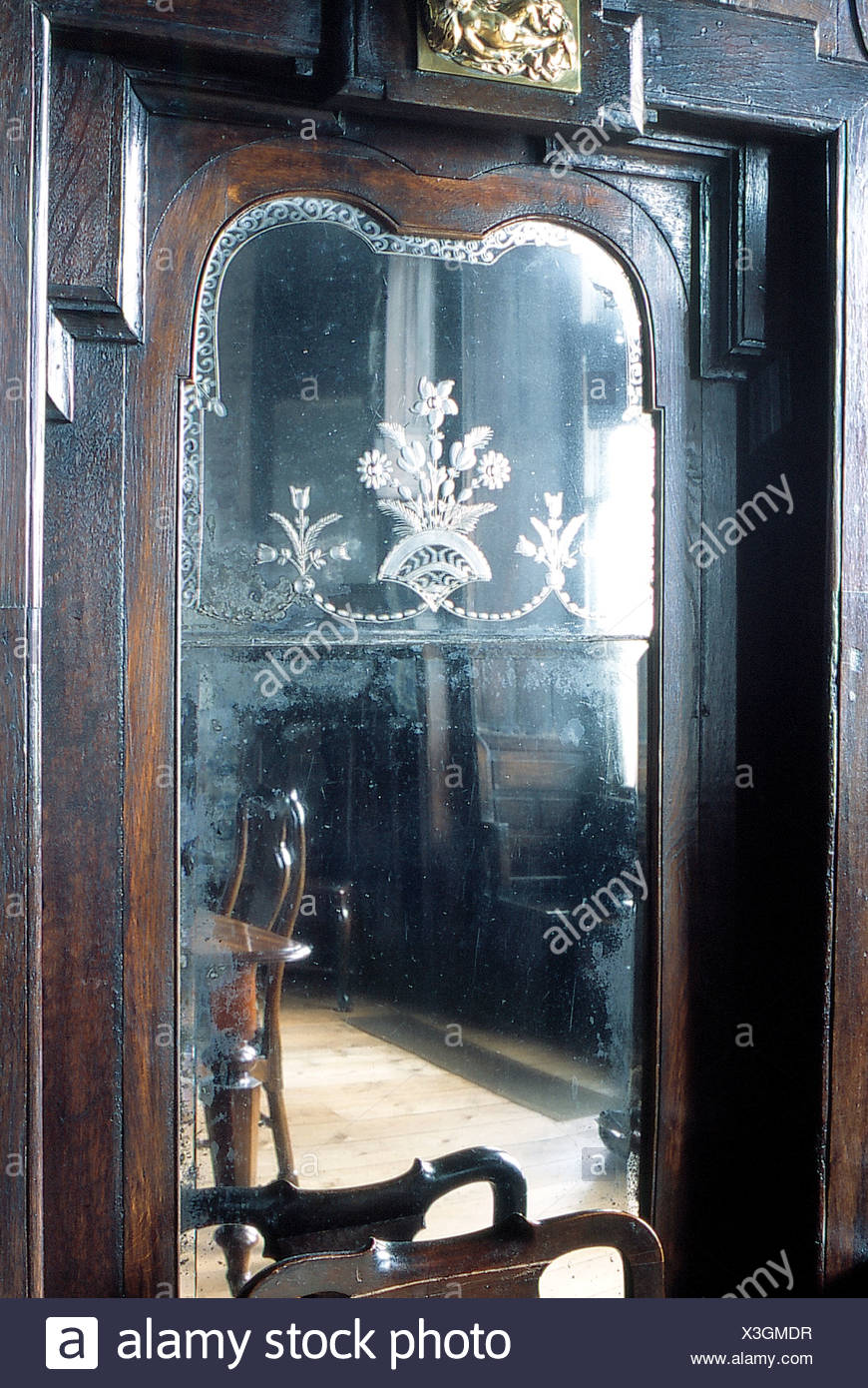 Reflection Of Country Dining Room In Antique Cupboard With Etched Glass Mirror Stock Photo Alamy