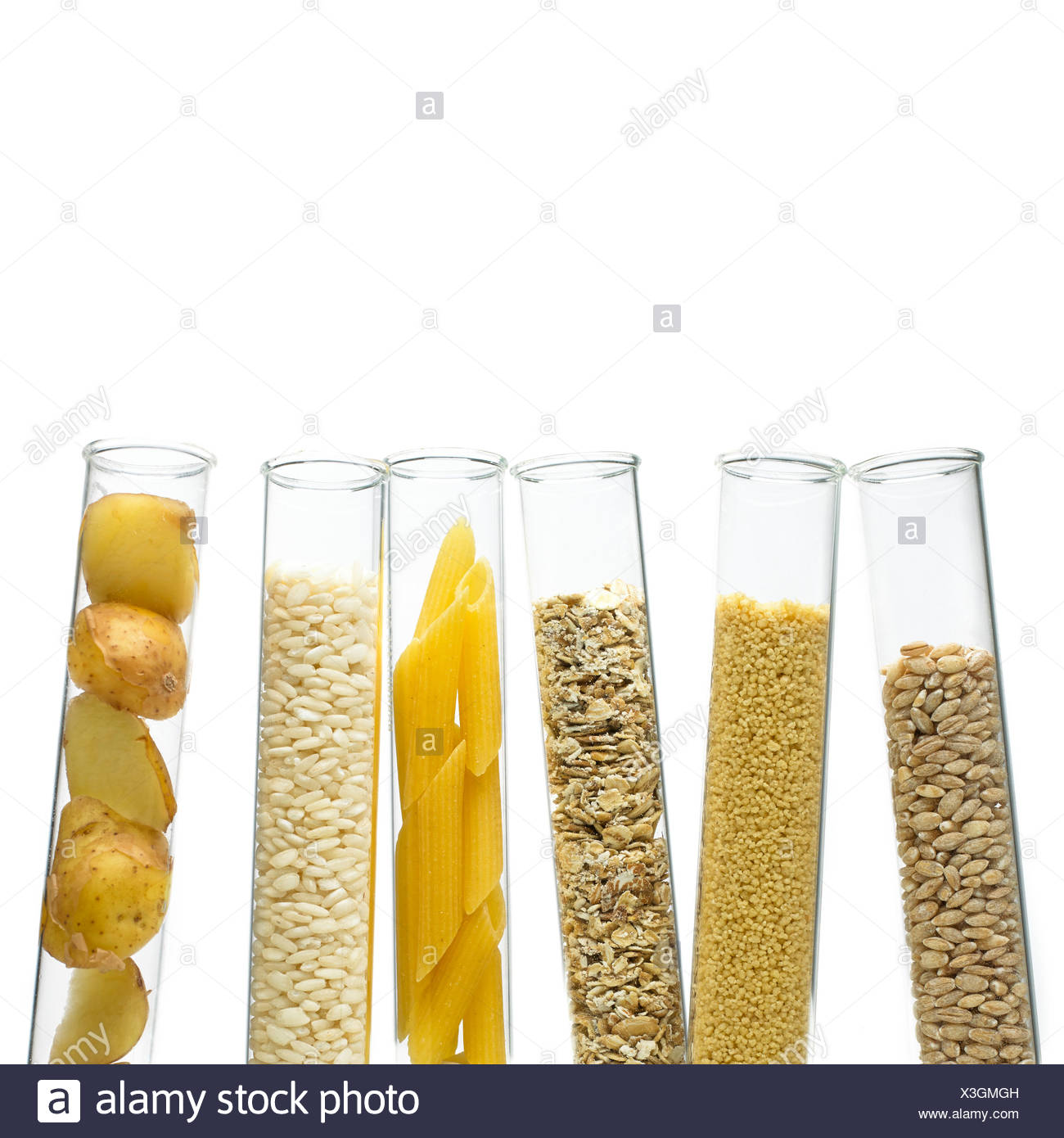 Grains and carbohydrates in test tubes - Stock Image