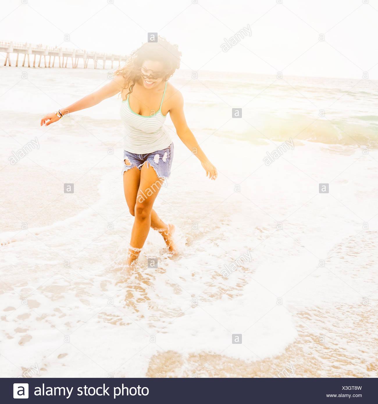 USA, Florida, Jupiter, Portrait of woman standing on beach - Stock Image