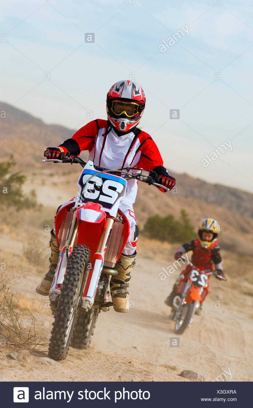 Mother And Son 5 6 On Motocross Bikes In Desert Stock Photo Alamy