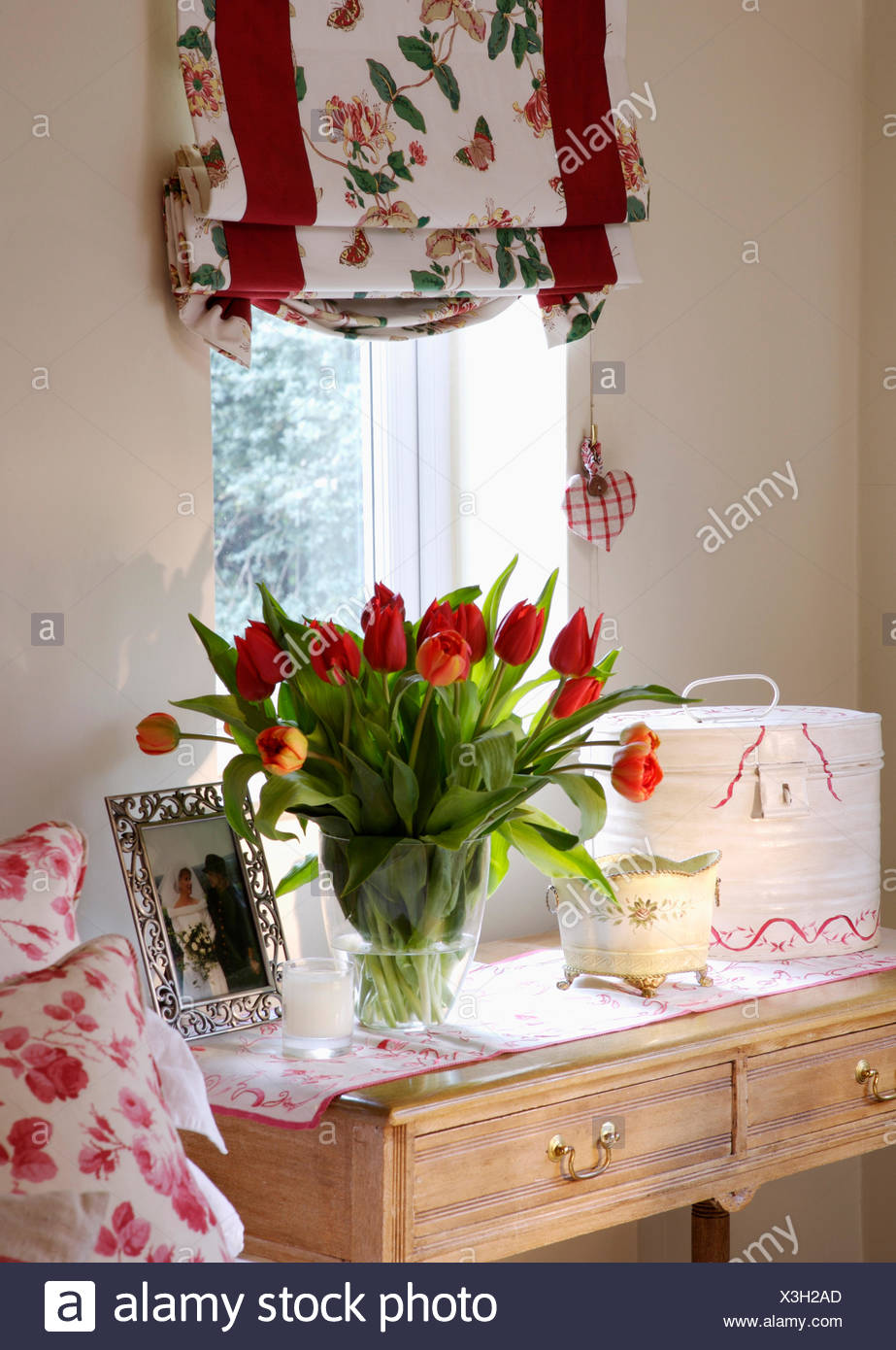 Vase country flowers on window stock photos vase country flowers floral blind on window above dressing table with vase of red tulips and framed photograph reviewsmspy