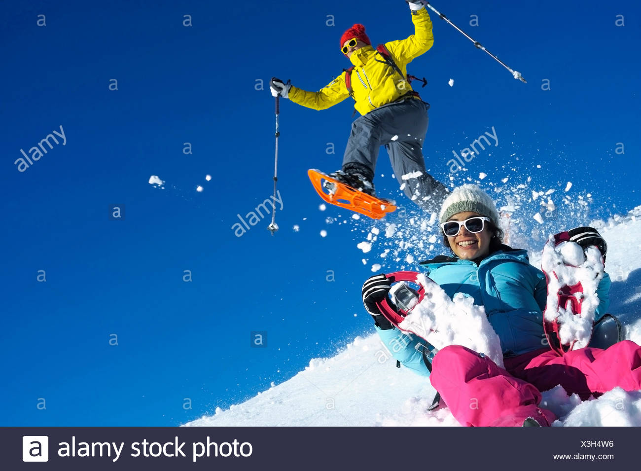 teenager jumping with snow shoes, France, Savoie, Val d Isere - Stock Image