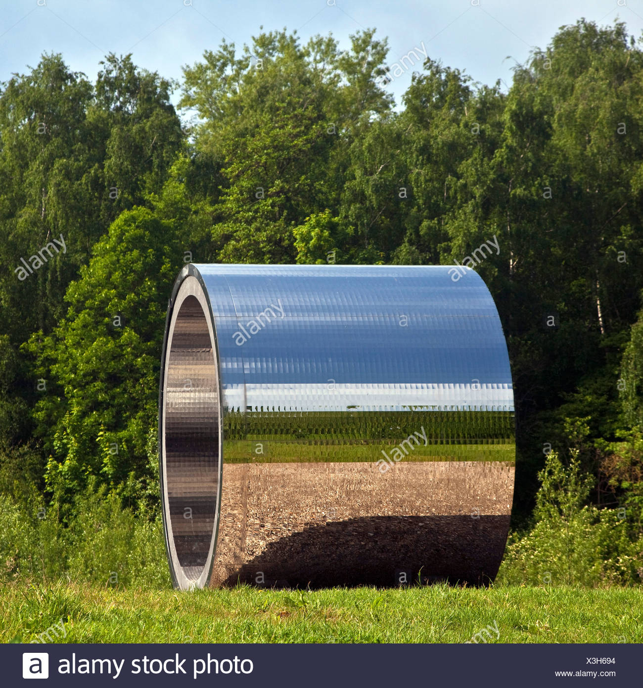 artwork 'Pixelroehre'  ('pixel tube') in a meadow at a forest edge near the mouth of river Koerne, Germany, North Rhine-Westphalia, Ruhr Area, Kamen - Stock Image