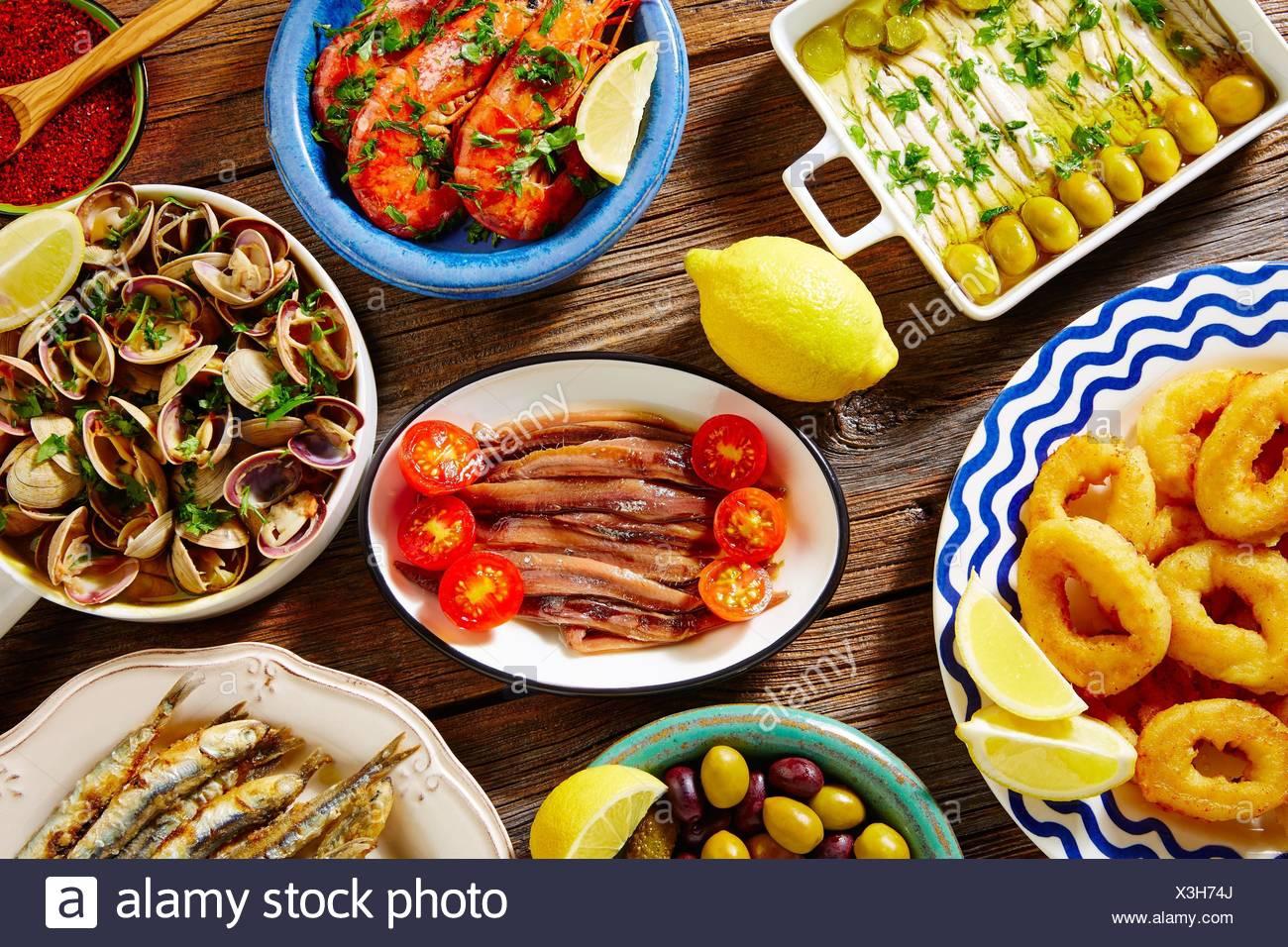 Tapas seafood clams shrimps calamari anchovies shrimps from Spain. - Stock Image
