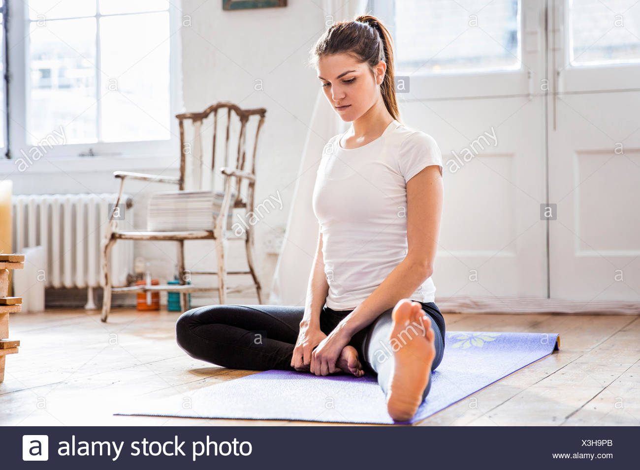 Young Woman Wearing Leggings Sitting Stock Photos & Young ...