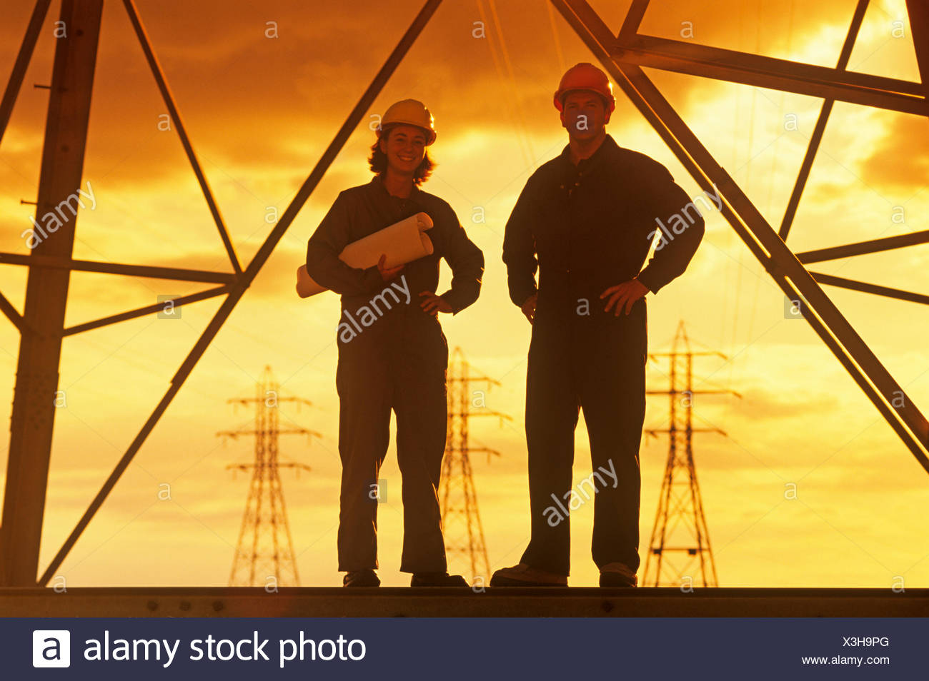 workers on an electrical tower, pylon, Manitoba, Canada - Stock Image