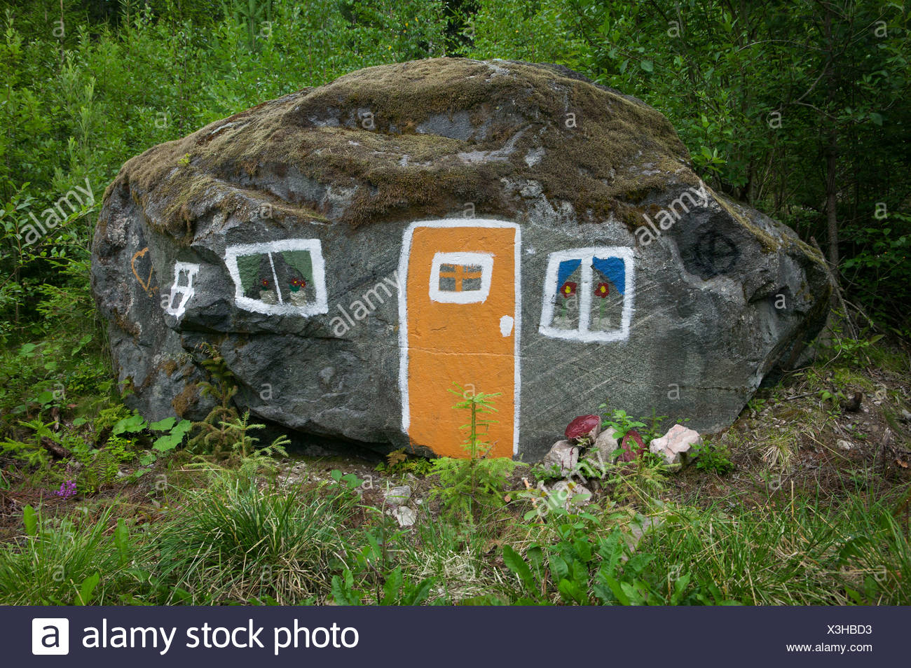 House painted on rock - Stock Image