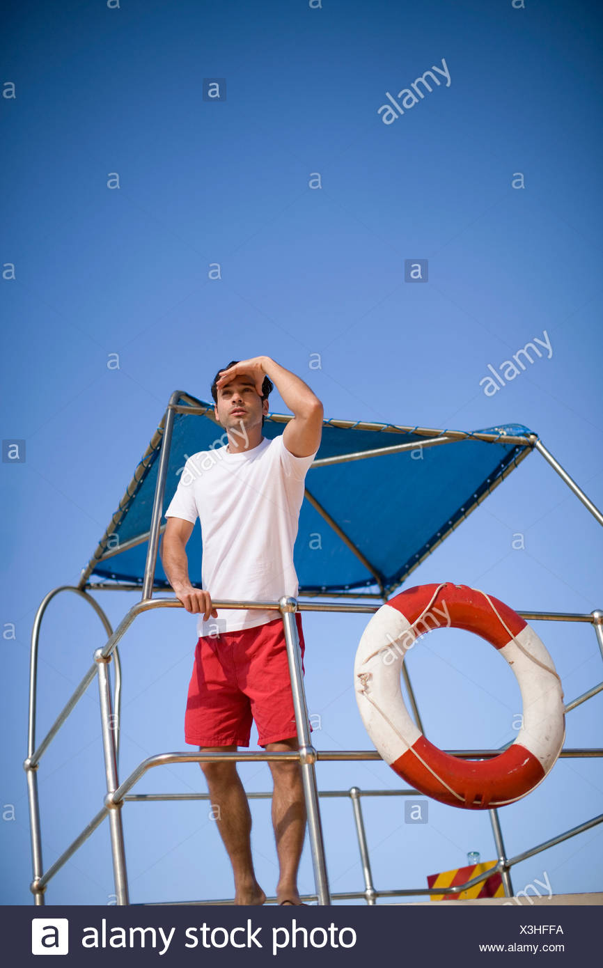 Lifeguard on lookout - Stock Image