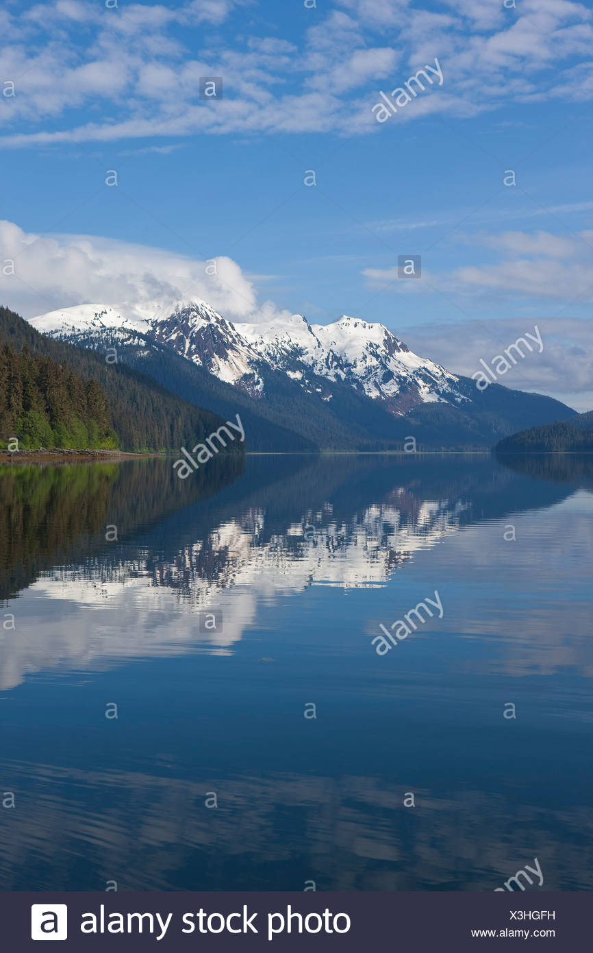 Clouds reflected in the calm waters of Seymour Canal, Admiralty Island, Tongass National Forest, Alaska, Windfall Island, Alaska Stock Photo