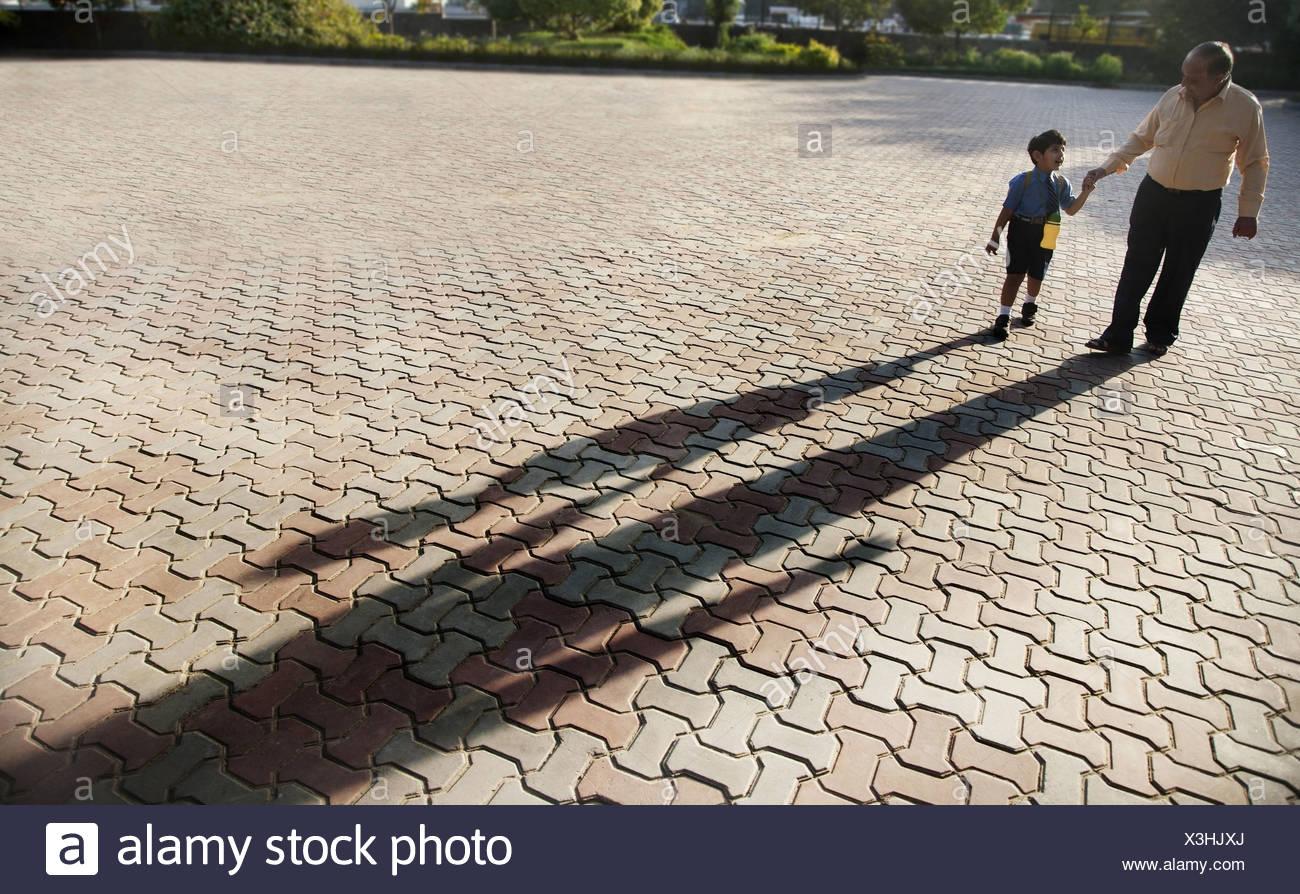 School boy holding his grandfathers hand Stock Photo